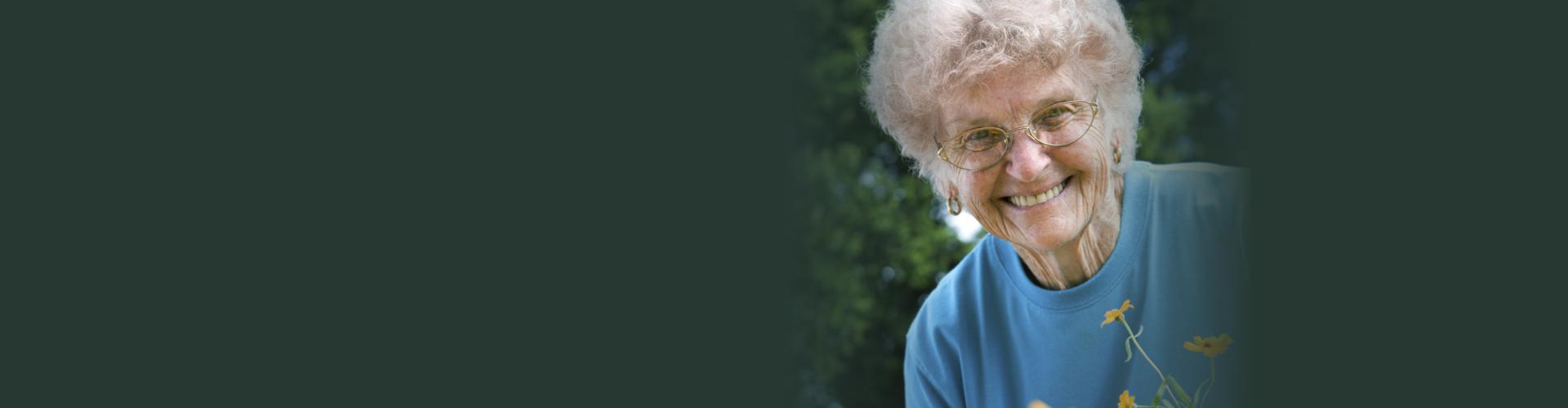 Female elder wearing blue shirt smiling